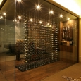 glass-wine-room-with-divider-rack