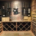 Custom Wine Cellar in Memphis Tennessee - wine room back wall with metal racks above and wood solid diamond bins below