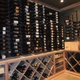 Metal Wine Racks and Custom Wine Racks Memphis Tennessee - wine room left wall with metal racks above and solid diamond bins and case storage below
