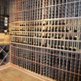 Unfinished Premium Redwood Custom Wine Racks Memphis Tennessee - wine room right wall with unfinished premium redwood racks one high reveal display row and three low reveal display rows