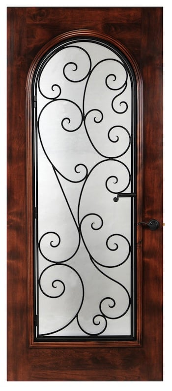 Operable wrought iron in a swirl pattern that makes for a beautiful showpiece. This wine cellar door features arched glass in a square door.