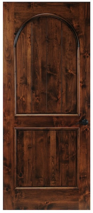 A design similar to our Bonita door with a full arched panel on top and a square panel on the bottom. Smaller trim is on each panel and the panels are made from vertical planks.