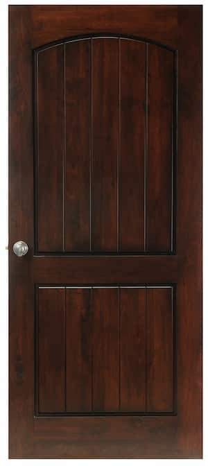 A solid wood door with vertical panels. The upper section features a wood eyebrow arched area in the square topped door. The bottom panel is square. Striking!