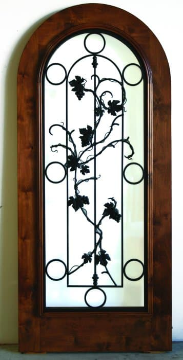 Operable grapevine design over clear glass. This is a beautiful arched door for any wine cellar.
