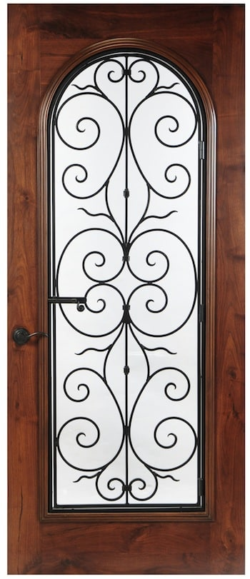 Swirls of operable wrought iron are featured on this wood door with arched glass and square top. Stunning.