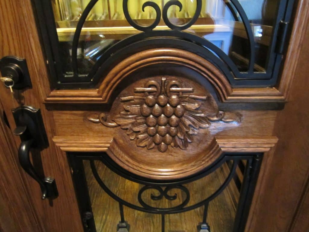 Custom Wine Cellar - McKinney Nr Dallas, Texas - Close up of hand carved grapevine design