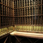 How to Build a Custom Wine Cellar - Wine Cellar Lighting LED over display row and Cooperage wine barrel tabletop