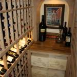 Left and back wall show racks in unfinished knotty alder Texas wine cellar