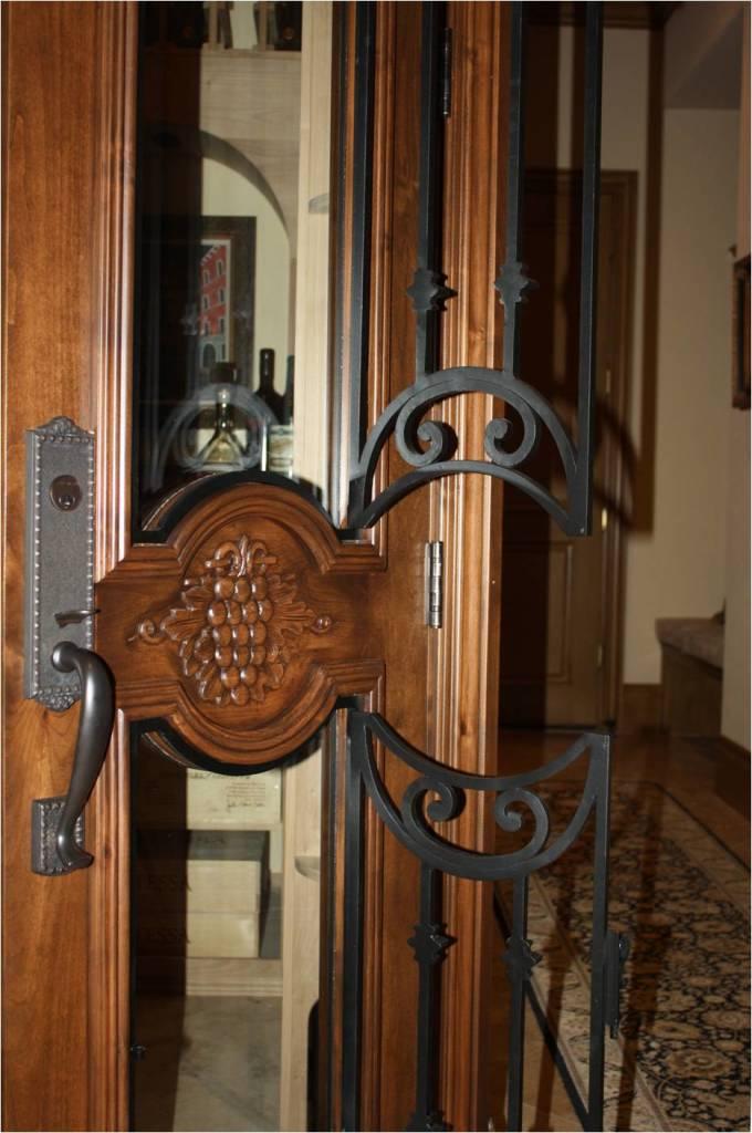 Texas wine cellar door_operable wrought iron
