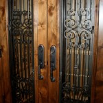 2 Black custom iron design on Knotty alder custom wine cellar doors with early american stain and lacquer