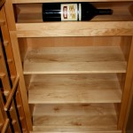 23 Horizontal magnum storage over 3 rows of solid case bins Teexas wine cellar display