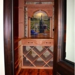 38. Doorway of Wine Room Showing Wine Barrel Flooring and Wood Racking