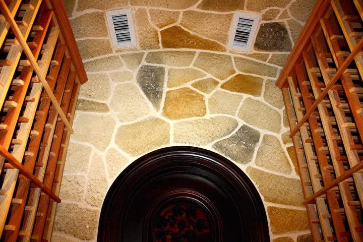 8. Custom Wine Cellar in Colleyville, Texas with Stone Walls and Ceiling