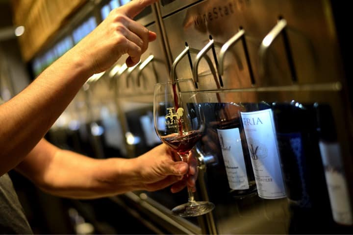 Dispensing a glass of wine from the Wine Station by Napa Technology