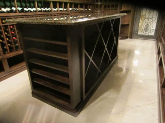 27Center Island with solid diamond bins and horizontal display racks. Granite countertop.