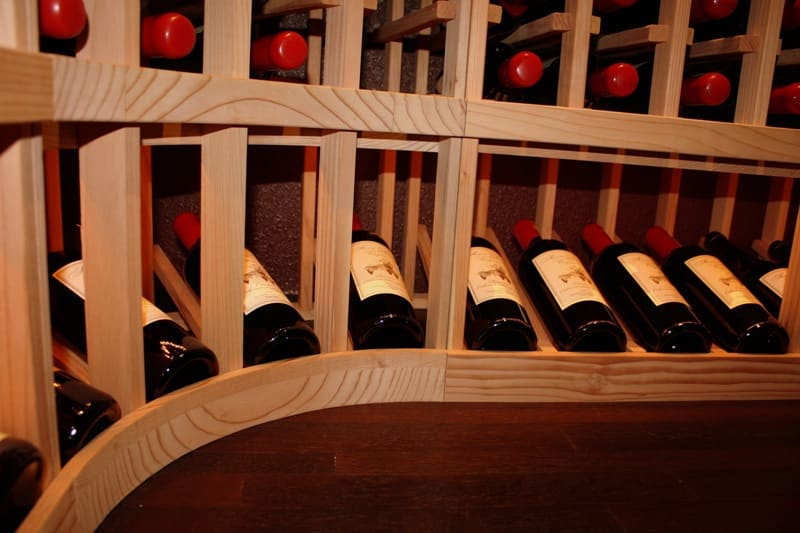 Redwood curved corner display wine rack
