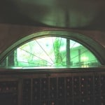 Stained Glass Double Pane Window with Sunburst Design and Green Antique Glass New Orleans Wine Cellar