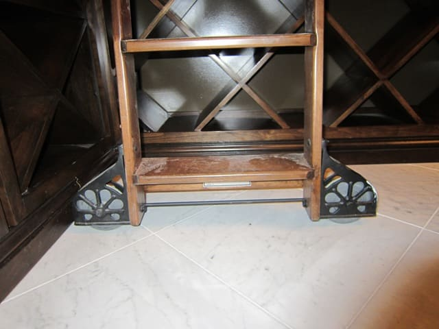 wine cellar rolling ladder with Sunburst wheels
