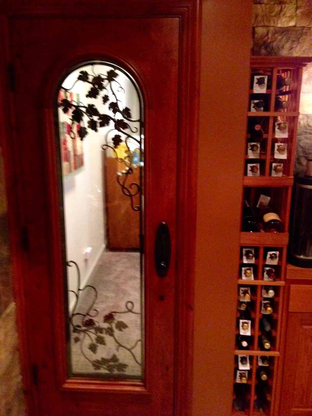 Wine Cellar Door - with duel pane glass, automatic door bottom and wrought iron grapevine design