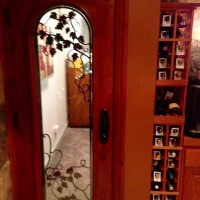 2 - Wine Cellar Door - with duel pane glass, automatic door bottom and wrought iron grapevine design