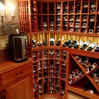 8 - Curved Wine Rack Corner with Lighted Display Row in Illinois Wine Room