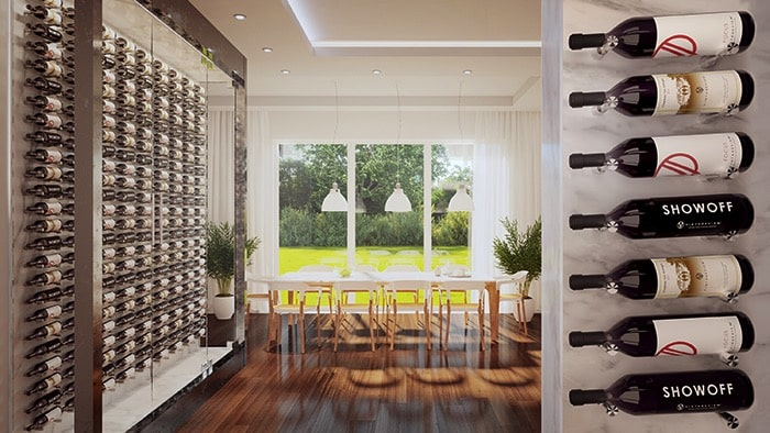In a lovely modern home sits a a glass wine cabinet to the left. Wine bottles are hanging by Vino PIns by VintageView, creating what appears as a piece of art in the residence.