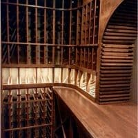 10. A closer view of the interior of the wood arch and lighted display row with wine racks.