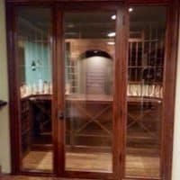 4. Custom wine cellar door, made from Knotty Alder in Chestnut stain and lacquer and double paned glass.