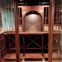 6. Looking into the wine cellar through the open door, see the custom crafted Knotty Alder arch as focal point.