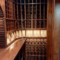 8. Inside this custom wine cellar in Atlanta, certain wines are highlighted with a lighted display row, along with beautiful racking above and below.