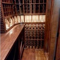 9. Wine cellar racks also provide rolling case storage at the base.