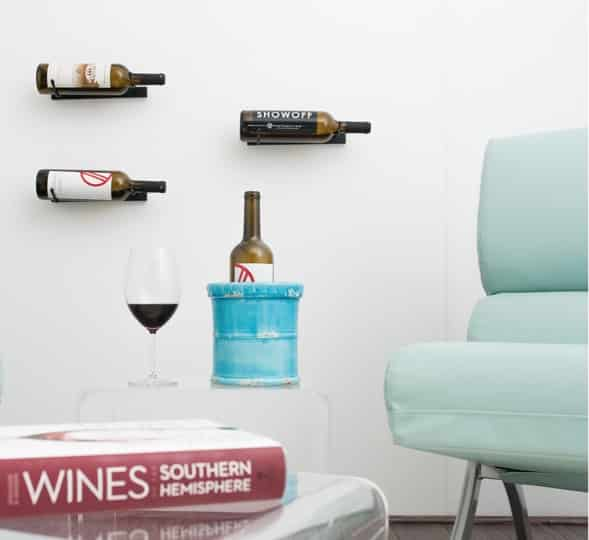Vino Styx by VintageView make for a modern display setting in a home's tasting room.