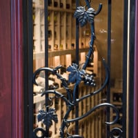 Hand forged grapevine wrought iron design on Tuscan door.