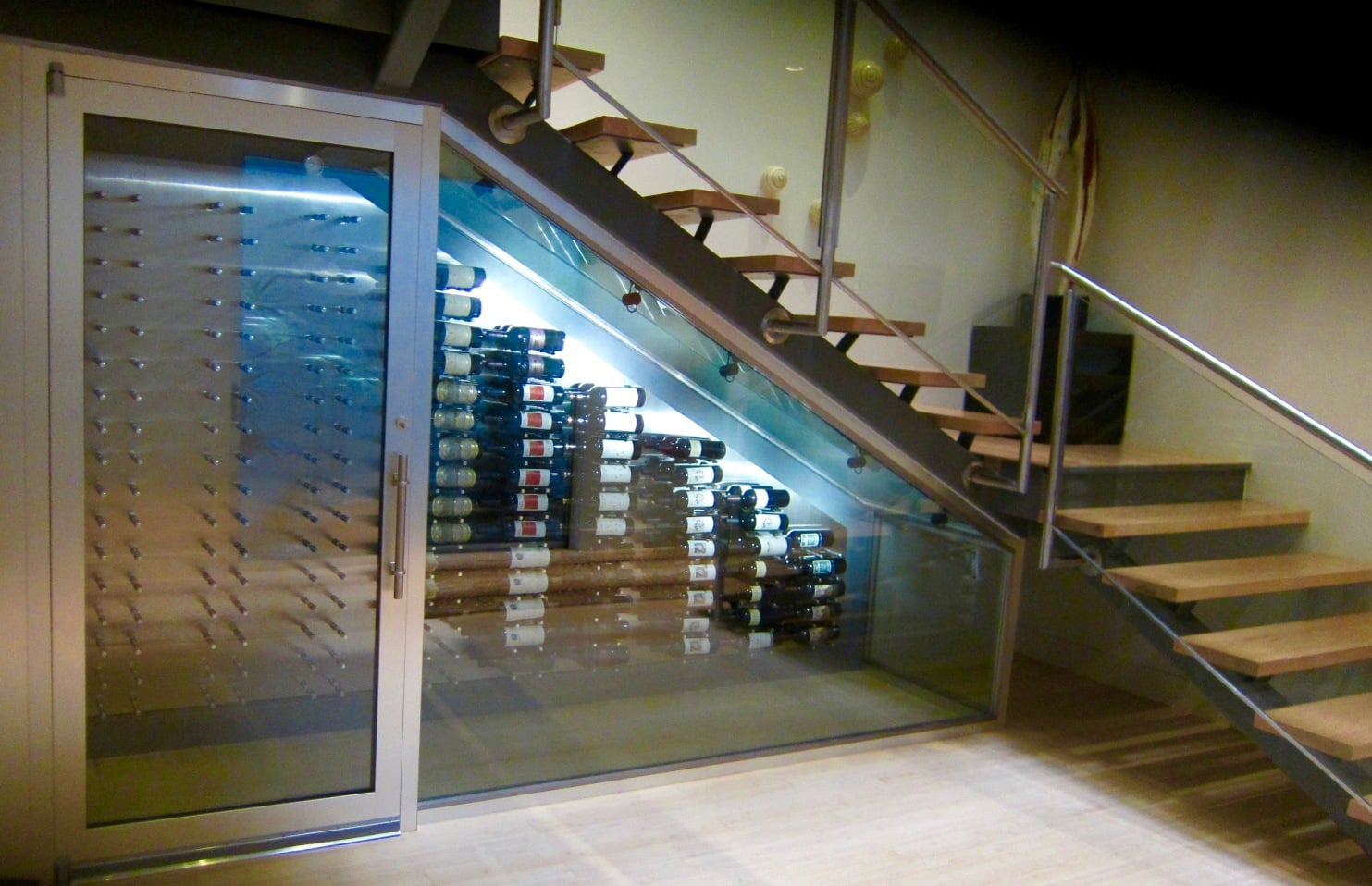 Modern Wine Cellar Dallas Contemporary Custom Wine Display Under Gravity-Defying Staircase in a Dallas Home