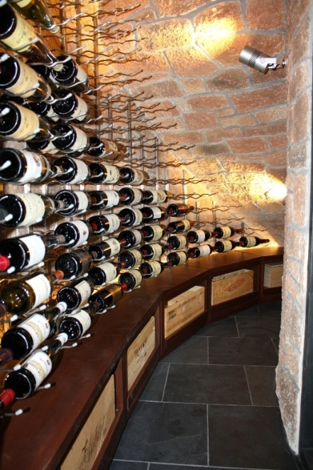 Case storage Below the Metal Wine Racks in a Home Wine Cellar