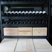 rolling wine case at the bottom, flat storage at the middle and angled reveal at the top