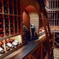 Angled view from other side of the wine storage in this custom wine cellar from Dallas- Fort Worth home