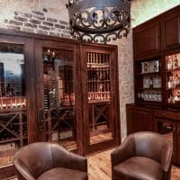 A look into the entertaining and storage areas of this wine cellar. An area like this will charm potential buyers, increasing the resale value of your home.
