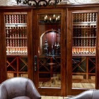 The room where most of the wine is stored in this Dallas-Fort Worth home is separated from the rest of the wine cellar with beautiful glass and wood doors. A custom space like this is quite the perk for potential buyers when you resell.
