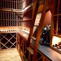 Inside a Dallas-Fort Worth Home, this wine cellar had lighting to showcase the valuable wine and beautiful decorations. Lighting, colors, and decoration choices all spur emotion, which is what increases a home\'s value when someone resales.