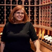 Nancy Higgins, owner of Wine Cellar specialists, inside this Dallas, Fort Worth custom wine cellar they helped build.
