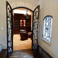 A different view of the wine cellar\'s door in this Dallas- Fort Worth home.