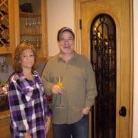 16 The Danns in Front of their New Home Wine Cellar