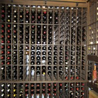 Large custom wine cellar with wooden wine racks with one bottle deep storage.