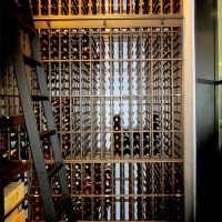 Custom wooden wine racks for a Massive wine cellar. Floor to celing wine storage for a huge collection of wine.