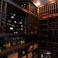 The massive storage of the wine room necessitated a ladder to reach the wines closer to the ceiling. The wine room can hold over 3000 bottles of wine.