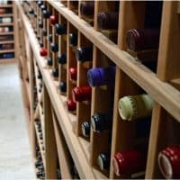 Unfinished Wine Racks Produce Clean Design for This Custom Traditional Cellar