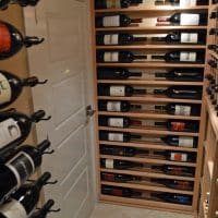 Door to Custom Traditional Wine Cellar and Racking for Magnum Collection