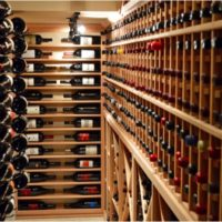 Custom wine racks were made to fit a variety of magnum sized bottles in this traditional cellar.