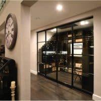 Custom Traditional Wine Cellar with Bronze Doors